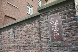 "The plaque outside of a church in Hamburg that reads ""There is nothing in which Jesus is not finished"""