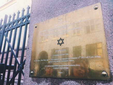 """The plaque outside the synagogue reads: """"In memory of Dan Uzan. At this place, Dan Uzan, age 37, was murdered by a terrorist on February 15th 2015, while protecting guests at the Jewish Community Centre. Evil can be vanquished through human kindness alone. Kindness takes courage."""""""