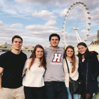 A few of my classmates and I by the London Eye